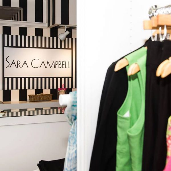 Stylist clothes stack the rack at a charming boutique.