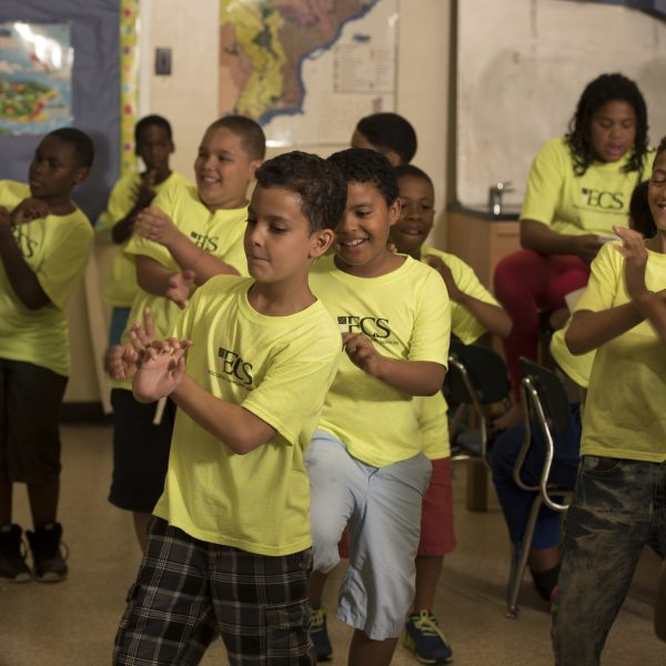 A group of elementary-aged boys perform a dance to a classroom-favorite song.